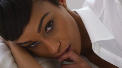 Black woman lying in bed