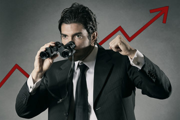Successful businessman with binocular