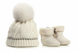 Warm woolen baby hat and booties over white