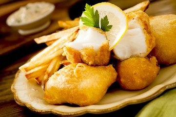 Closeup of fresh halibut fish and chips with tartar sauce.