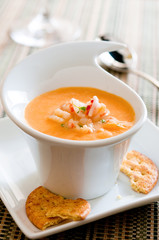 closeup of lobster bisque with crackers