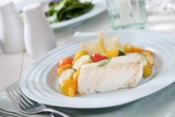 healthy lunch with cod and steamed vegetables.
