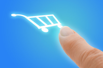 Buy Now Touch Screen Finger Pointing to Shopping Cart Icon