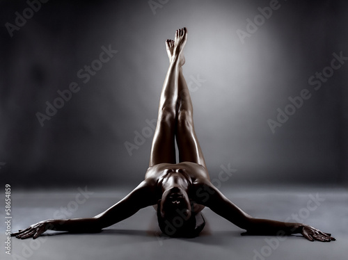 Silhouette of excited naked woman with slim legs