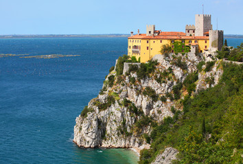 Gothic Duino castle on a cliff over the Gulf of Trieste , Italy.