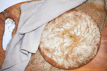 Rye and cornmeal rustic bread loaf