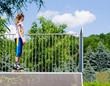 Teenage girl in rollerblades on a ramp