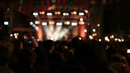 many people at concert area and light show
