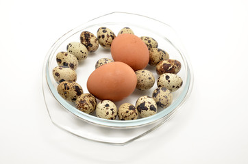 different eggs in glass bowl