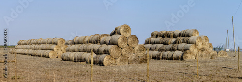 View of a stack of hay bales on the countryside.