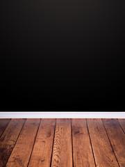 Parkettfußboden mit schwarzer Wand