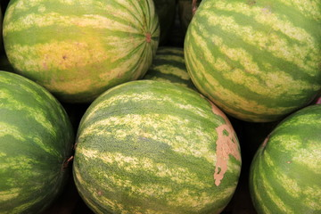 Several watermelons at farmers market