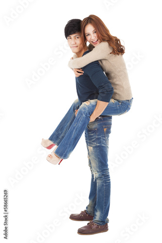 happy young couple standing and hugging