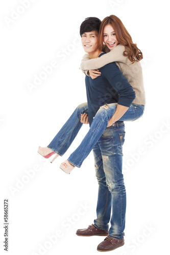 full length young couple standing and hugging