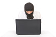 Man in black mask with computer looking at camera