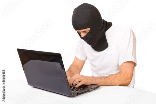 Man in black mask looking at monitor
