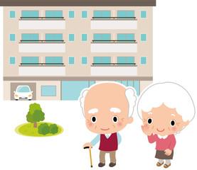 高齢者の男女とマンション