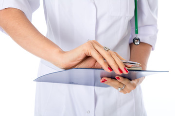 Closeup hand of a doctor with writing tablet. Diagnosis