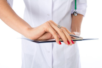 Closeup hand of a doctor with writing tablet.