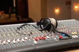 headphones on Audio Mixing Board Sliders in the theatre