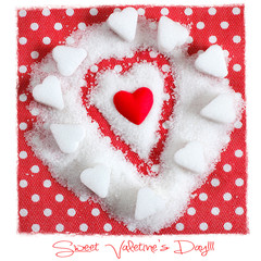 Heart in sugar on red background. Valentines symbol