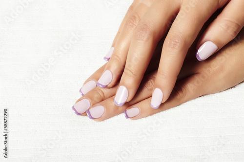 manicure.female hands.in beauty salon.shellac polish