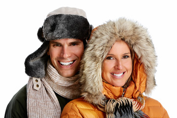 Happy christmas couple in winter clothing.