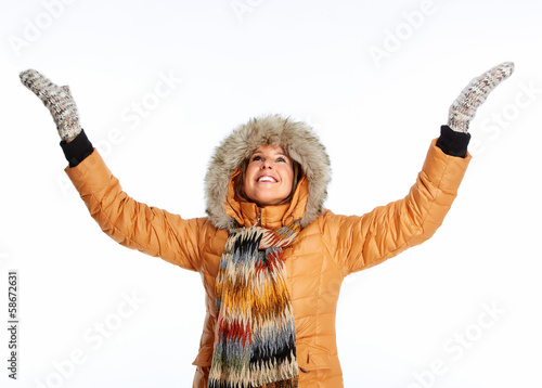 Young woman wearing winter coat.