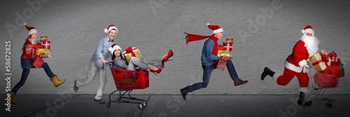 Happy people running with xmas gifts.