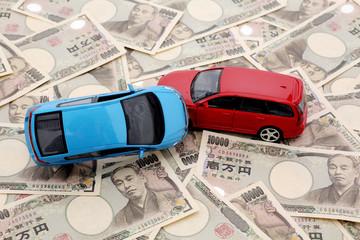 一万円とミニカー