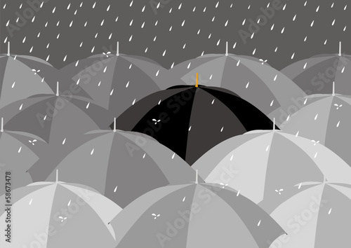 Black umbrella among lighter colour umbrellas