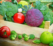 Organic fruits and vegetables in a creates