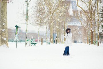 Beautiful young woman in Paris on a snowy day