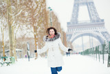 Girl happily jumping in Paris on a winter day