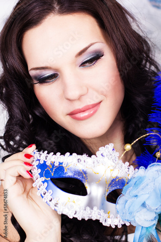 Sexy woman with mask. New Year time
