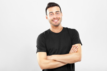 Smiling guy with crossed arms
