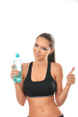 Fitness lady holding a bottle of water and giving thumbs up