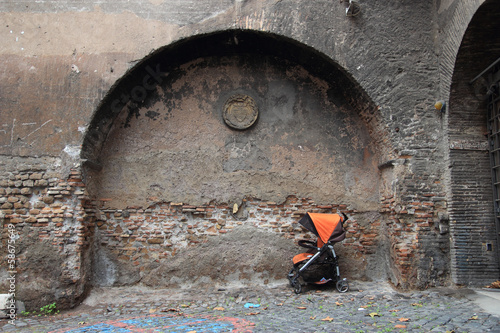 stroller over ancient wall