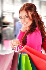 Young woman with shopping bags in the store