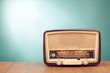canvas print picture - Old retro radio with green eye light on table