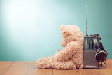 Retro toy Teddy Bear, radio receiver, headphones