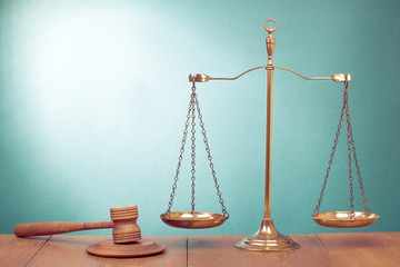Law scales, judge gavel on table. Symbol of justice concept