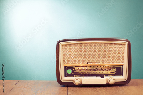 canvas print picture Old retro radio with green eye light on table