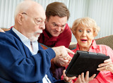 Seniors and Adult Son with Tablet PC