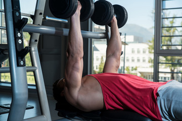 Men Working Out With Dumbbells
