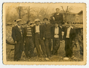 CIRCA 1940: Group of men and boys on private land