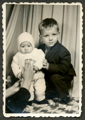Two children, siblings, joint photograph - circa 1960