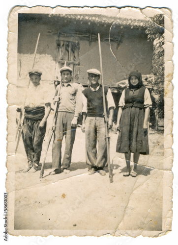 CIRCA 1930 - Villagers in front of house