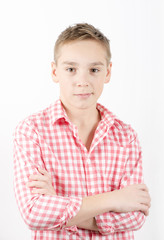 Caucasian teenager standing in checkered shirt, white background
