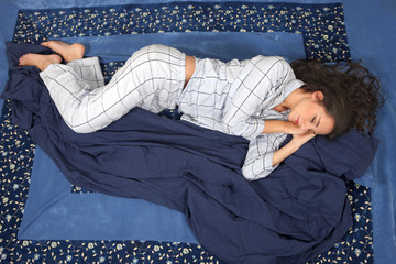 Woman sleeping in side position, comfort in bed